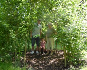 Three generations enjoying the willow dome